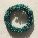 pulsera arsenal de piedras, mostacilla y perlas, en tonos verde, aqua y celeste