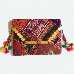 Indian envelope clutch bag. Made of vintage fabric panels. Decorated with coins and mirrors and pompom tassels