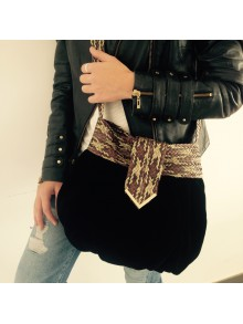 Bolso de terciopelo con asa trenzada en dorado